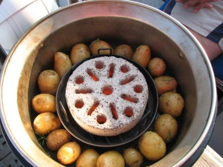 While you bake fish, sausage, vegetables or whatever above, the potatoes are happily baking below.