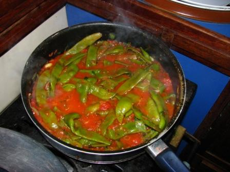Our favorite green beans are cooked in rich tomato sauce.
