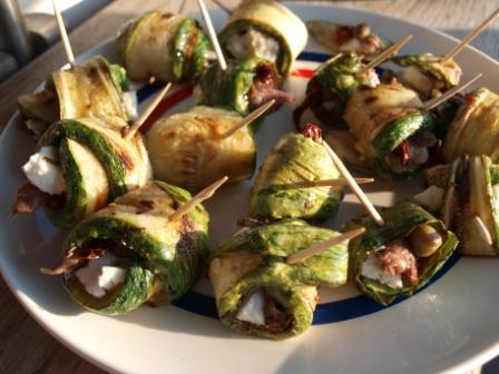 Garlic baked zuccini rolls with feta, sun dried tomato, anchovies and capers
